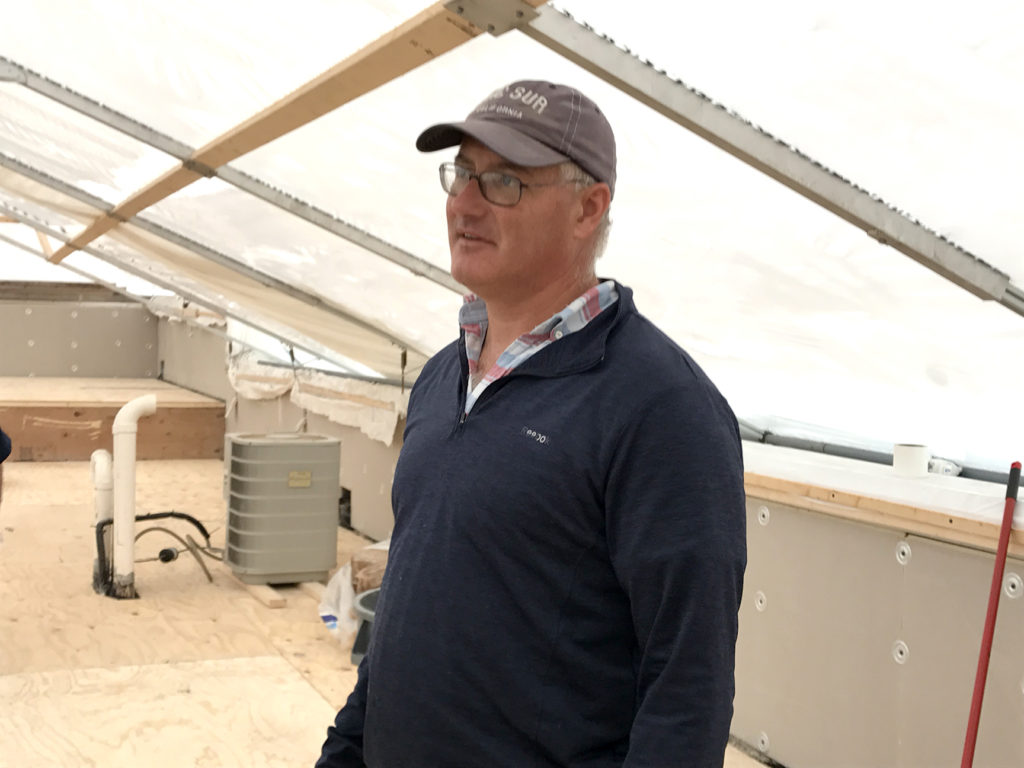 Bob Kelly inside an installed 365 Construction Tent